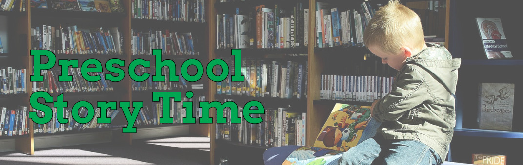child reading book in library, preschool story time